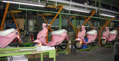 Genuine Buddy scooters on the assembly line